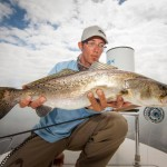 Capt. Justin Price's big belly speckled Trout in the Mosquito Lagoon.