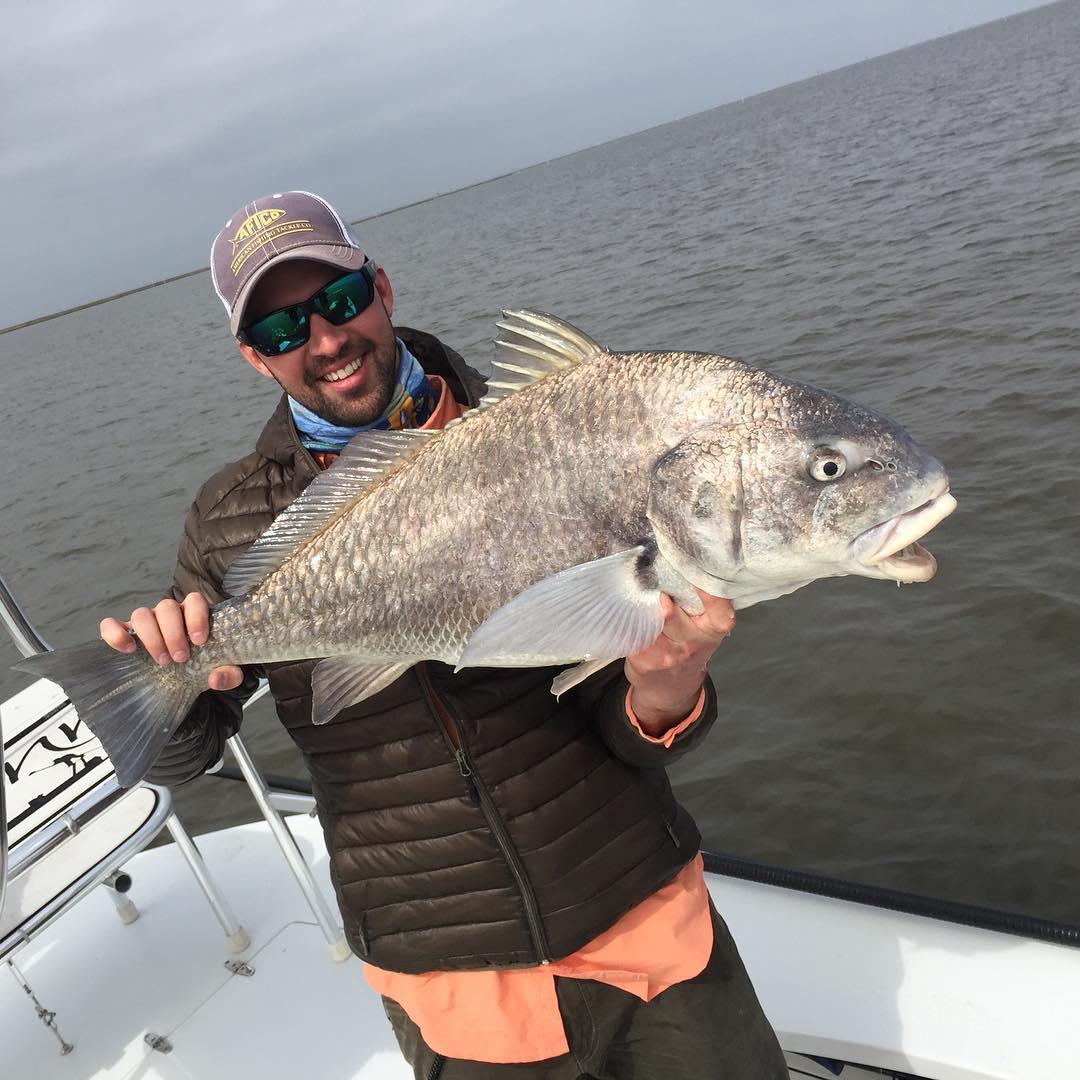 Our good friend @ericfey catching I bug ole nasty black drum! #redfishing #redfi...
