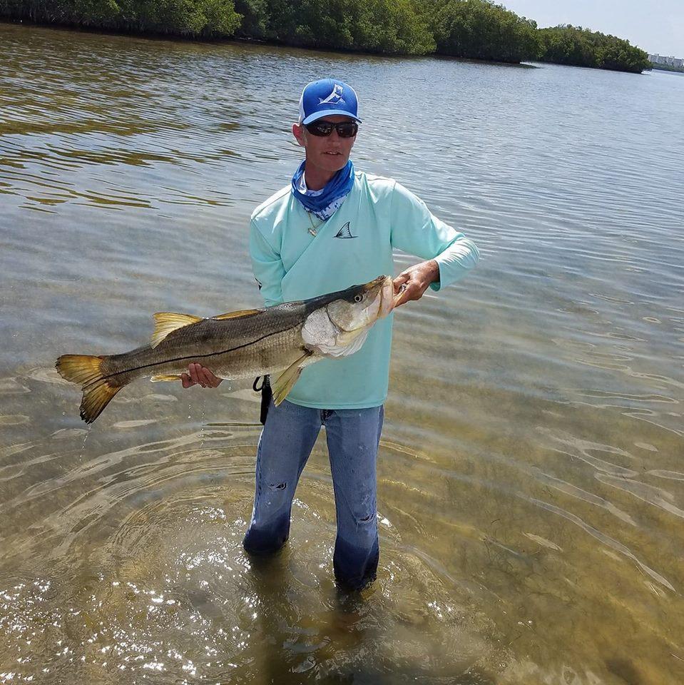 Kerry's new favorite Skiff Life fishing hat & fishing shirt