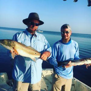 Doubled up on a bunch of redfish this morning  caught his pb redfish and a stud …