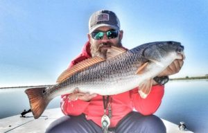 Captain  with a chunky Red that he found in  skinny water! . . .   …
