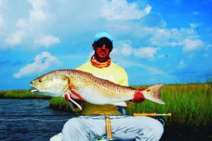 Bull  caught on fly. – Nice Rainbow to frame it! – from our photo archives – . ….
