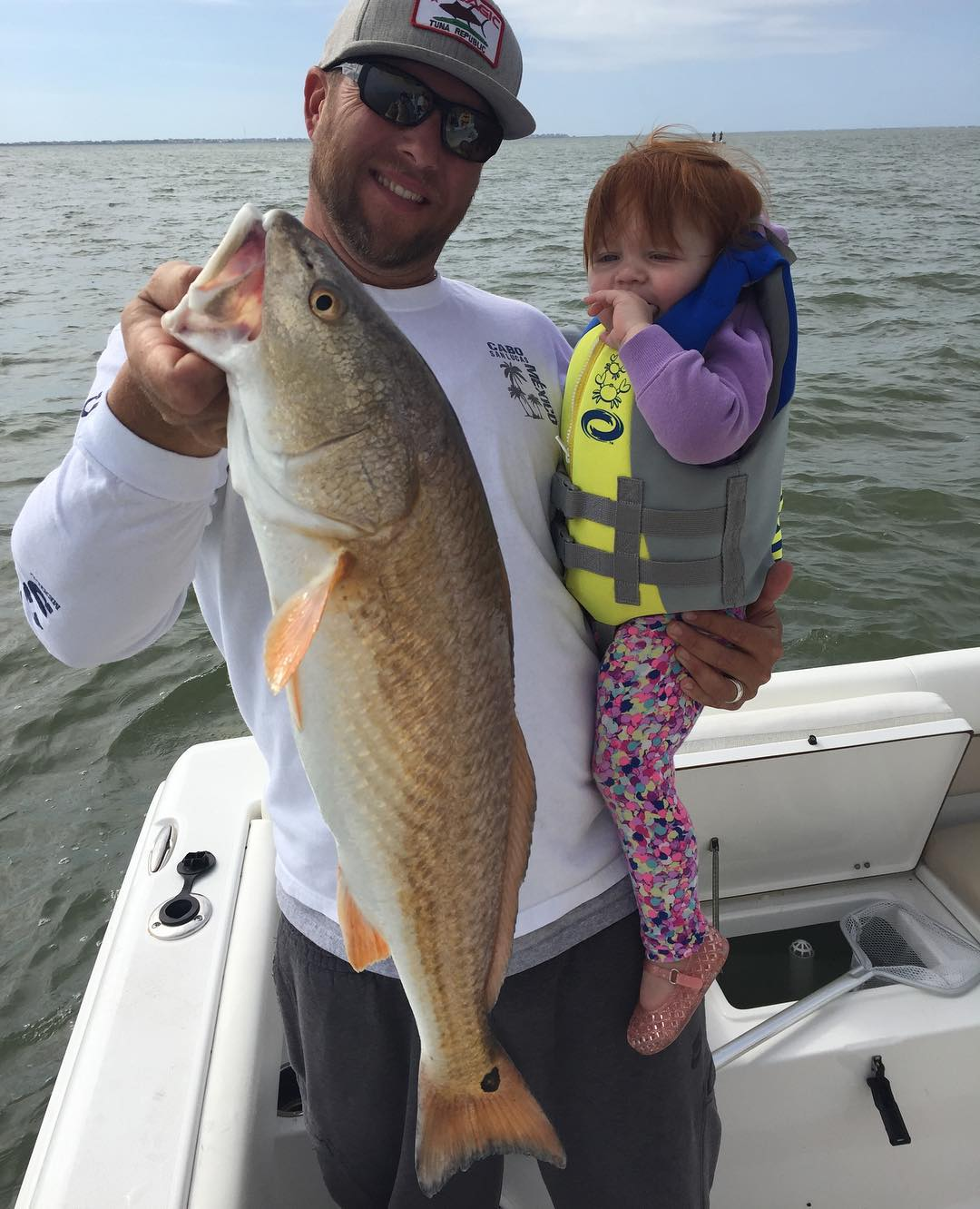 when you catch a red as big as your kid   ...