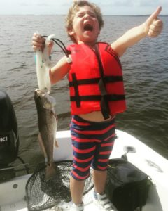 Jax is a happy fisherman!! He's outfished everyone on Reds & Trout!             …