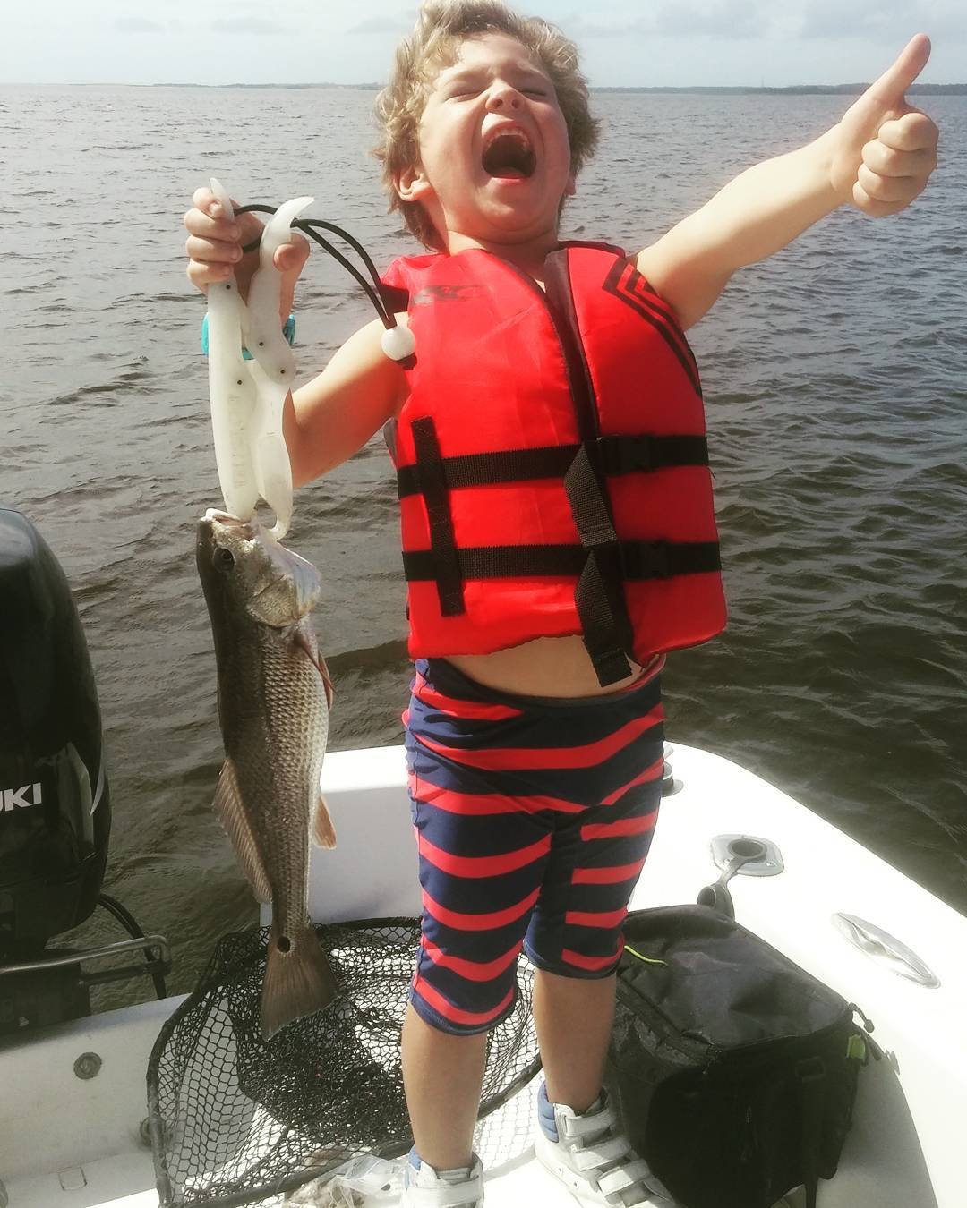 Jax is a happy fisherman!! He's outfished everyone on Reds & Trout!             ...