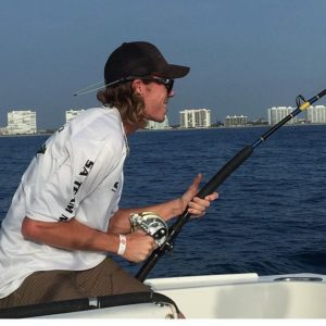 Reeling in a king fish with                                …