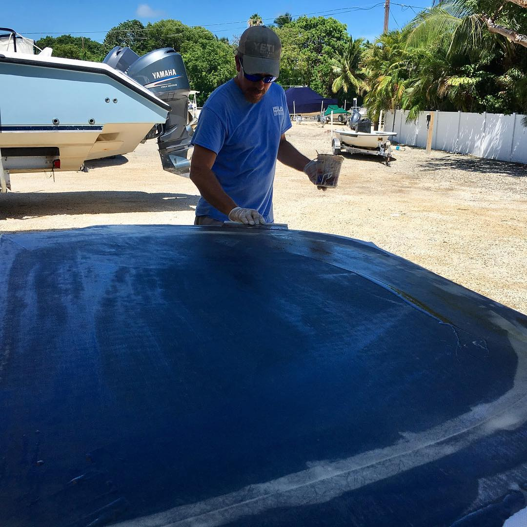 Brian laminating a custom bow deck for a 15 Whaler..       ...