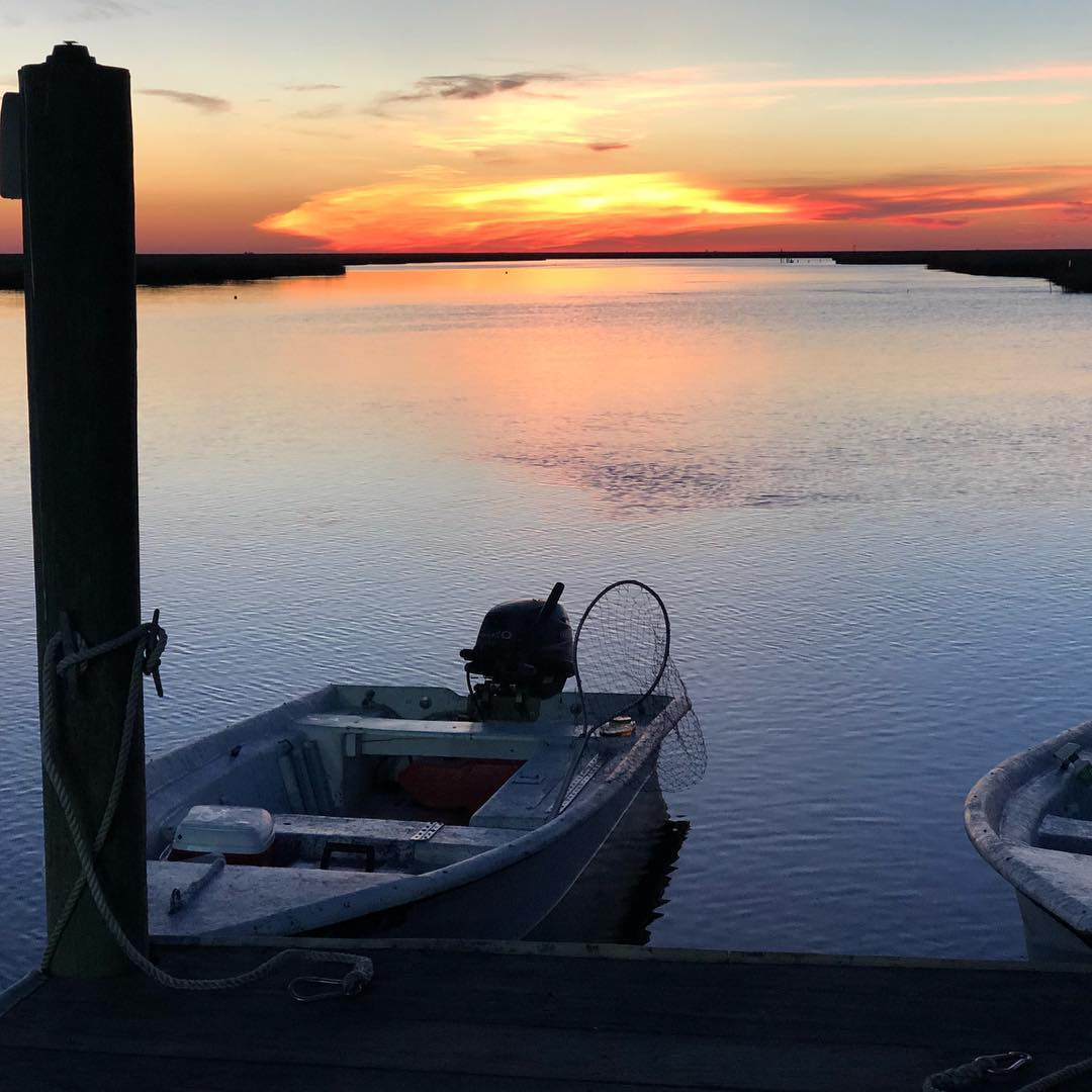 My view at sunset. The last of the skiffs back at dock