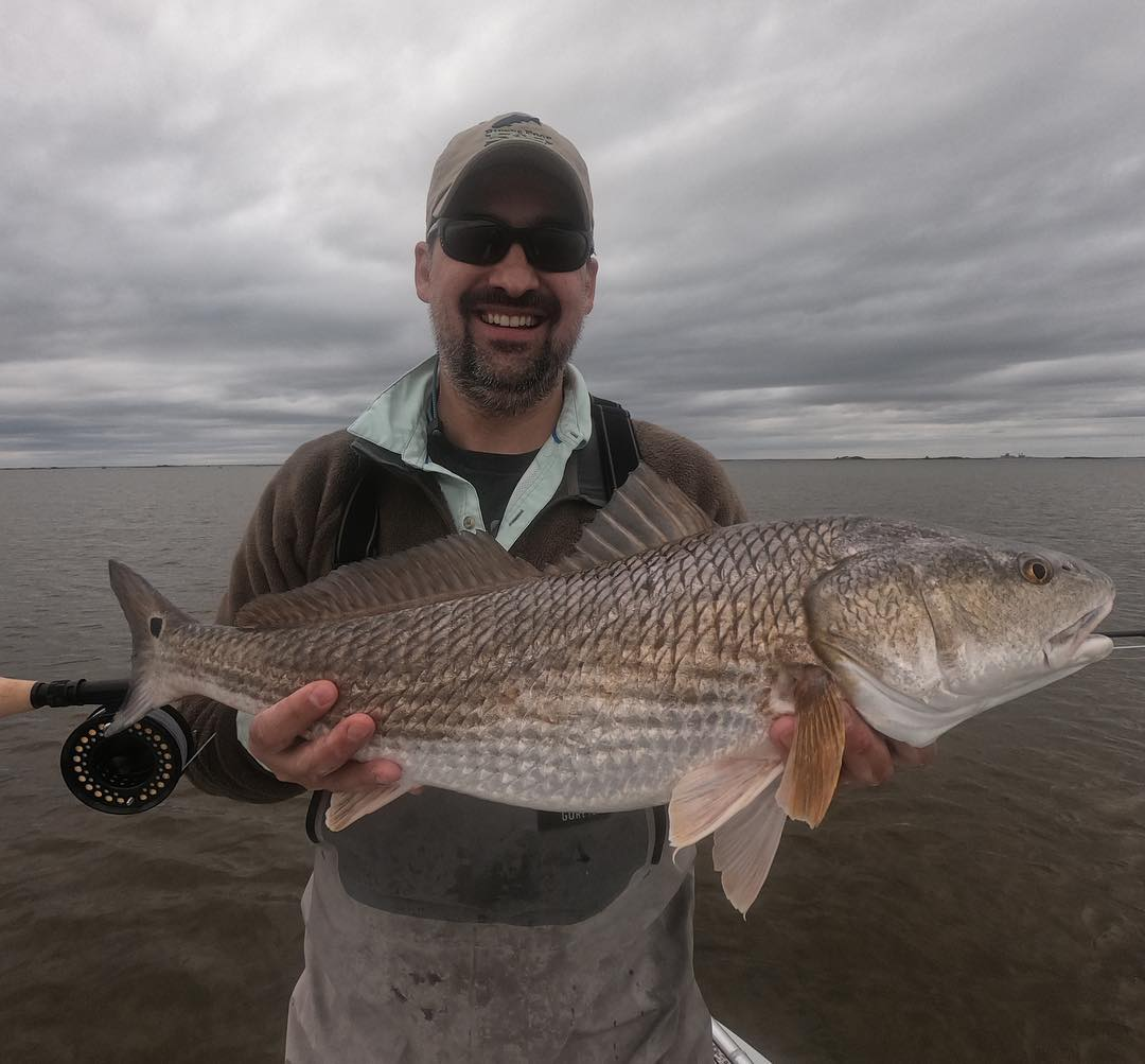 Grey skies, redfish. Jeremy got to experience some unreal sightcasting in some n