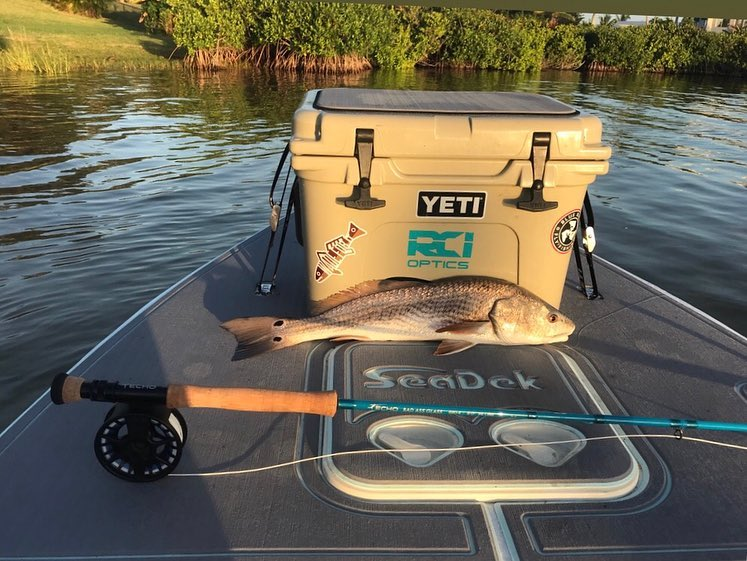 Redfish sliming the new  on my boat, they did an awesome job! . . . . .