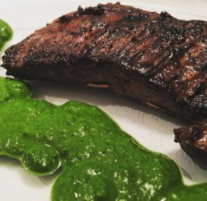 Carne Asada with Chimichurri sauce.  Notes of garlic, cilantro, mint, lime, and