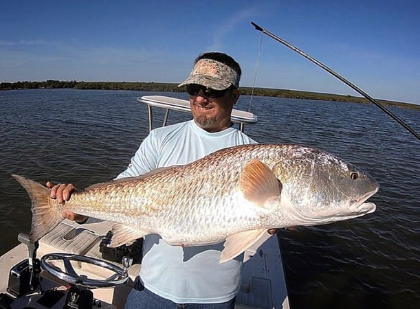 Jarrod with an awesome redfish!