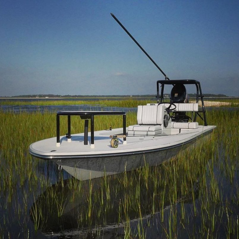 Beavertail Mosquito skiff floats in spit.