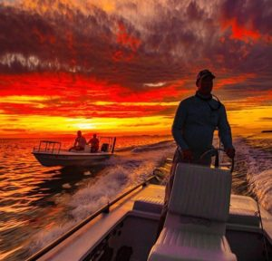 @sport_fish_gallery sunsets and skiffs always make a great combination! DM / tag…