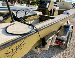 "Some call us the ""monster garage"" for skiffs.. Here is one of two Hell's Bay's t"
